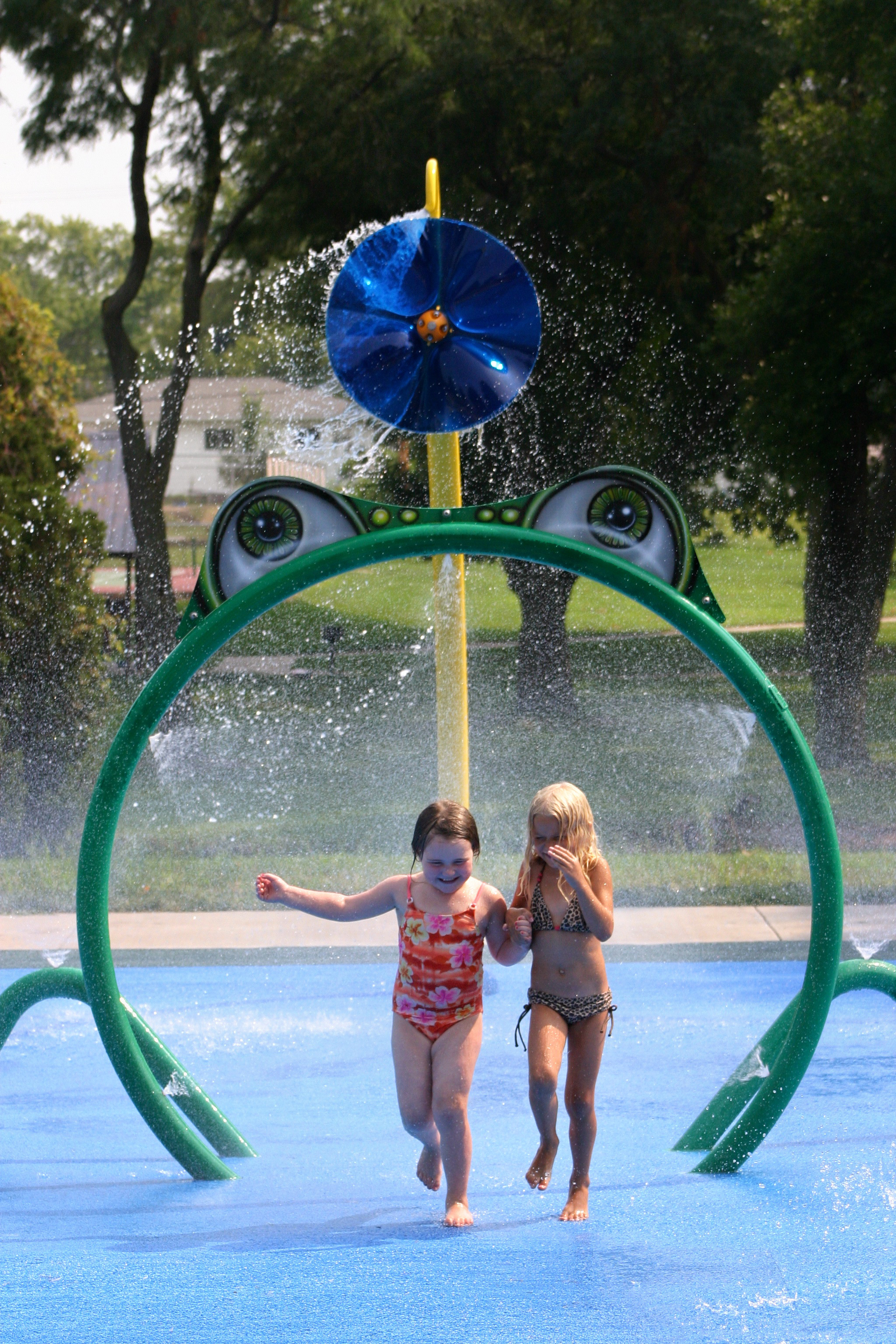 Two children at a splash pad